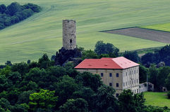 Manor house and castle tower. Royalty Free Stock Photos