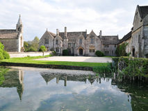 Manor House Exterior and Grounds. Manor House and Grounds Surrounded by a Moat Royalty Free Stock Images