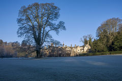 Manor House Hotel with a big tree on the meadow in Castle Combe Stock Images