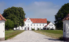 Manor house mansion. White manor house or mansion or mini castle with long drive.big farm in denmark by ebeltoft royalty free stock photo