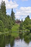 Manor house by the river Royalty Free Stock Images