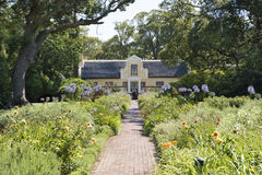 Manor house, beautiful garden stock images