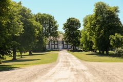 Manor house with trees in front royalty free stock photo