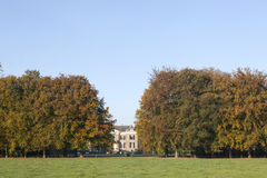 Manor huis doorn in the netherlands near utrecht. Behind beach trees in the fall Royalty Free Stock Image