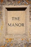 The Manor sign carved in Cotswold stone. Stock Images