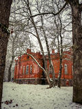 Manor in winter. Brick manor house in winter royalty free stock image
