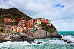 Manorolla in the Sun. Manorola of Cinque Terre on the North Western coast of Italy sits colorfully while waiting out a late spring storm Royalty Free Stock Photos