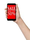 Manos adolescentes femeninas que muestran el teléfono móvil con oferta de la venta Fotografía de archivo libre de regalías