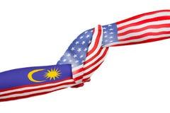 Manos amigas de los Estados Unidos de América y de Malasia Imagen de archivo