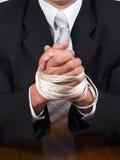 Manos atadas del hombre de negocios Fotografía de archivo libre de regalías