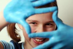 Manos azules Imagenes de archivo