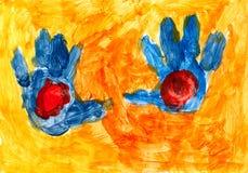 Manos azules en el fondo anaranjado Fotos de archivo libres de regalías