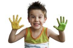 Manos coloreadas niños. Manos del niño pequeño. foto de archivo