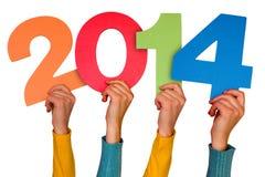 Manos con el año 2014 de las demostraciones de los números Fotos de archivo