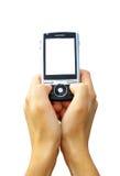 Manos con el comunicador Foto de archivo libre de regalías