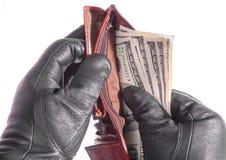 Manos con guantes con un monedero Fotografía de archivo