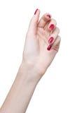 Manos con la manicura roja imagen de archivo libre de regalías