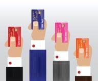 Manos con la tarjeta de crédito Foto de archivo
