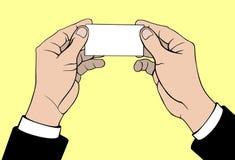 Manos con la tarjeta de visita Foto de archivo libre de regalías