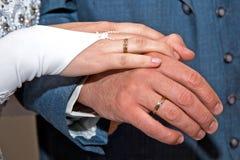 Manos con los anillos Foto de archivo