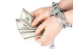 Manos con los dólares en encadenamiento Imagenes de archivo