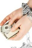 Manos con los dólares en encadenamiento Fotografía de archivo