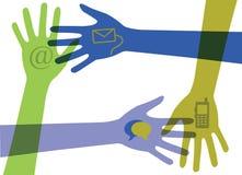 Manos con los iconos de la comunicación Foto de archivo libre de regalías