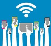 Manos con los teléfonos y las tabletas con wi fi imagen de archivo libre de regalías