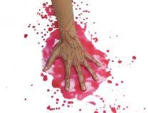 Manos con sangre en el fondo blanco Foto de archivo libre de regalías