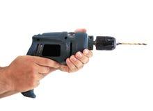 Manos con un taladro eléctrico sucio Foto de archivo