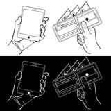 Manos con un teléfono y una cartera Fotos de archivo libres de regalías