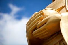 Manos de la estatua de Buddha fotos de archivo