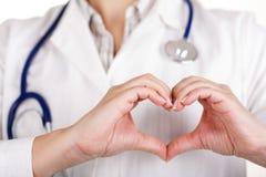 Manos de la forma del corazón Imagen de archivo libre de regalías
