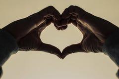 Manos de la forma del corazón Fotografía de archivo libre de regalías