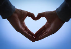 Manos de la forma del corazón Imagen de archivo