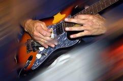 Manos de la guitarra Imagen de archivo libre de regalías