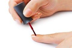 Manos de la mujer - esmalte de uñas Imagen de archivo