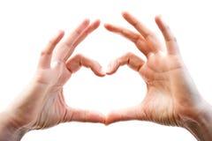 Manos de la mujer que muestran el gesto del corazón, aislado fotos de archivo