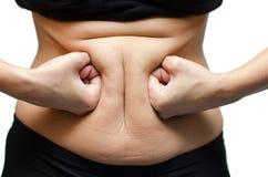 Manos de la mujer que perforan el estómago Fotografía de archivo libre de regalías