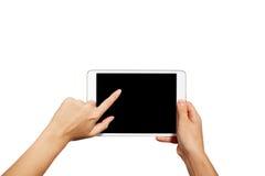 Manos de la mujer que sostienen la PC genérica contemporánea de la tableta fotografía de archivo libre de regalías