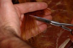 Manos de los aparadores del pelo Foto de archivo