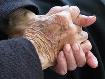 Manos de los jubilados Imagen de archivo