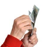 Manos de Man'n con los billetes de dólar Fotos de archivo libres de regalías
