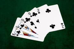 Manos de póker - rasantes - clubs Imagenes de archivo