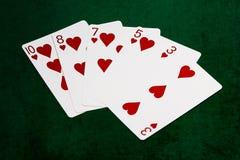 Manos de póker - rasantes - corazones Fotografía de archivo