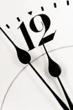 Manos de reloj casi doce Fotos de archivo libres de regalías