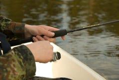 Manos de un pescador Foto de archivo libre de regalías