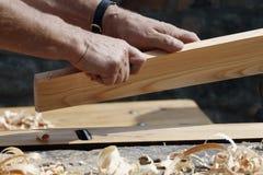 Manos del carpintero Foto de archivo