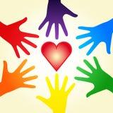 Manos del corazón y del arco iris Imagen de archivo