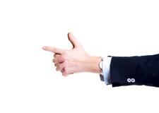 Manos del hombre de negocios del primer, señalando como un arma Fotografía de archivo